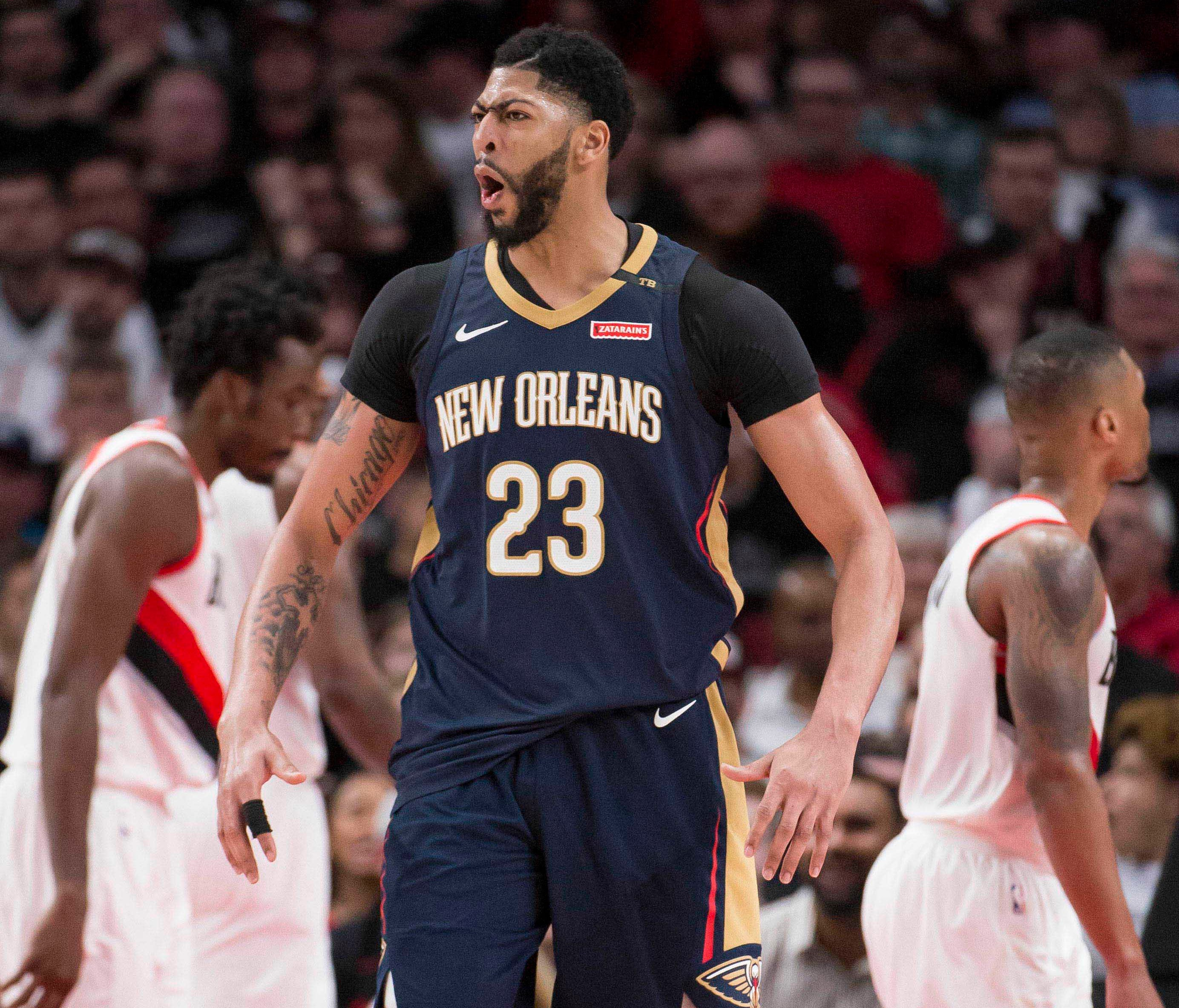 Anthony Davis celebrates after scoring in the Pelicans' Game 1 win over the Trail Blazers.