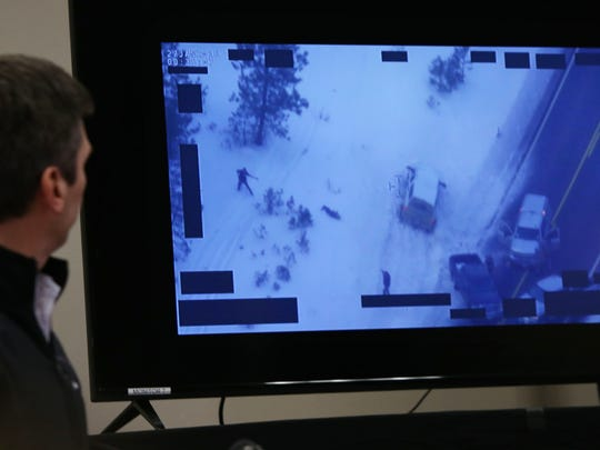 Greg Bretzing, special agent in charge for the FBI in Portland, presents video of the shooting of Robert Finicum, shown at center left on the monitor, a spokesman for the armed occupiers of a wildlife refuge, during a press conference in Burns, Ore., Thursday, Jan. 28, 2016.