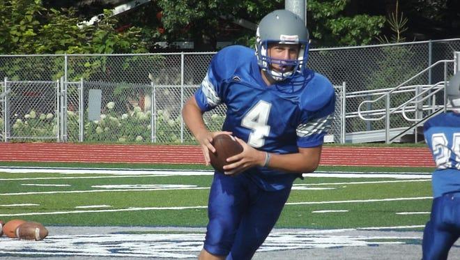 Green Bay Southwest senior quarterback Clayton Ladsten takes an option play upfield at practice Wednesday.