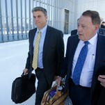 """This Dec. 18, 2015, file photo, San Juan County Commissioner Phil Lyman, left, and his attorney Peter Stirba, right, leave the federal courthouse, in Salt Lake City. Lyman, convicted for his role in an ATV protest ride through a protected canyon calls the case against him a """"modern-day witch hunt"""" in documents filed before a federal appeals court."""