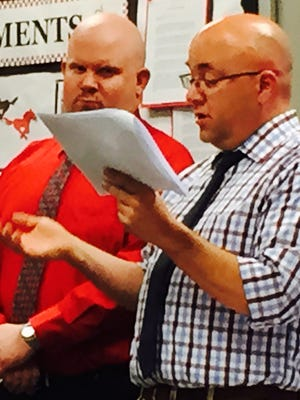 Kyle Kauffman, right, and Zachary Sheerer, left, president and vice president of South Western Education Association, presented the 2016 PEPPer (Public Education Partners and Promoters) awards at the May 25 board meeting.
