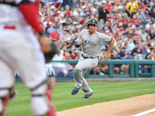 New York Yankees first baseman Greg Bird (33) runs towards home plate as he scores a run during the second inning against the Philadelphia Phillies at Citizens Bank Park.