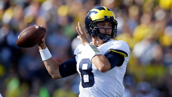 John O'Korn throws against Purdue in the first half of Michigan's 28-10 win in West Lafayette, Ind. on Sept. 23, 2017.
