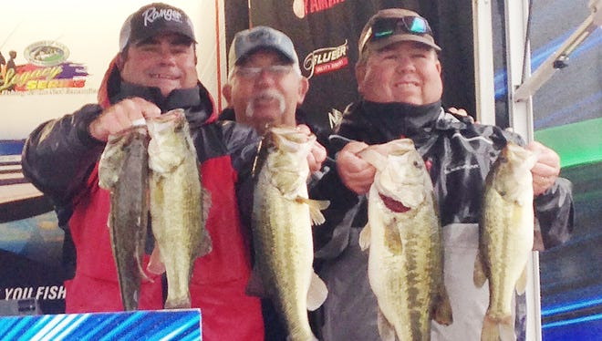 Shannon Denson (left) and Webb Collums (right) show of their winning fish with director Bobby Eades  after winning the FOM Division 6 Championship on Barnett Reservoir.