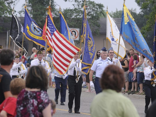 The Color Guard leads the parade in Rice.