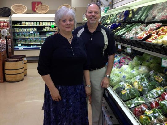Terrie and Gary Baker stand in their Coshocton IGA store in this 2014 file photo. The couple told employees on Tuesday that the store will be closing next month. The couple owns five stores in the region with the Coshocton store opening in 1987.