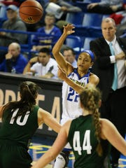 Simone DeFreese, No. 22, passes into the paint in the