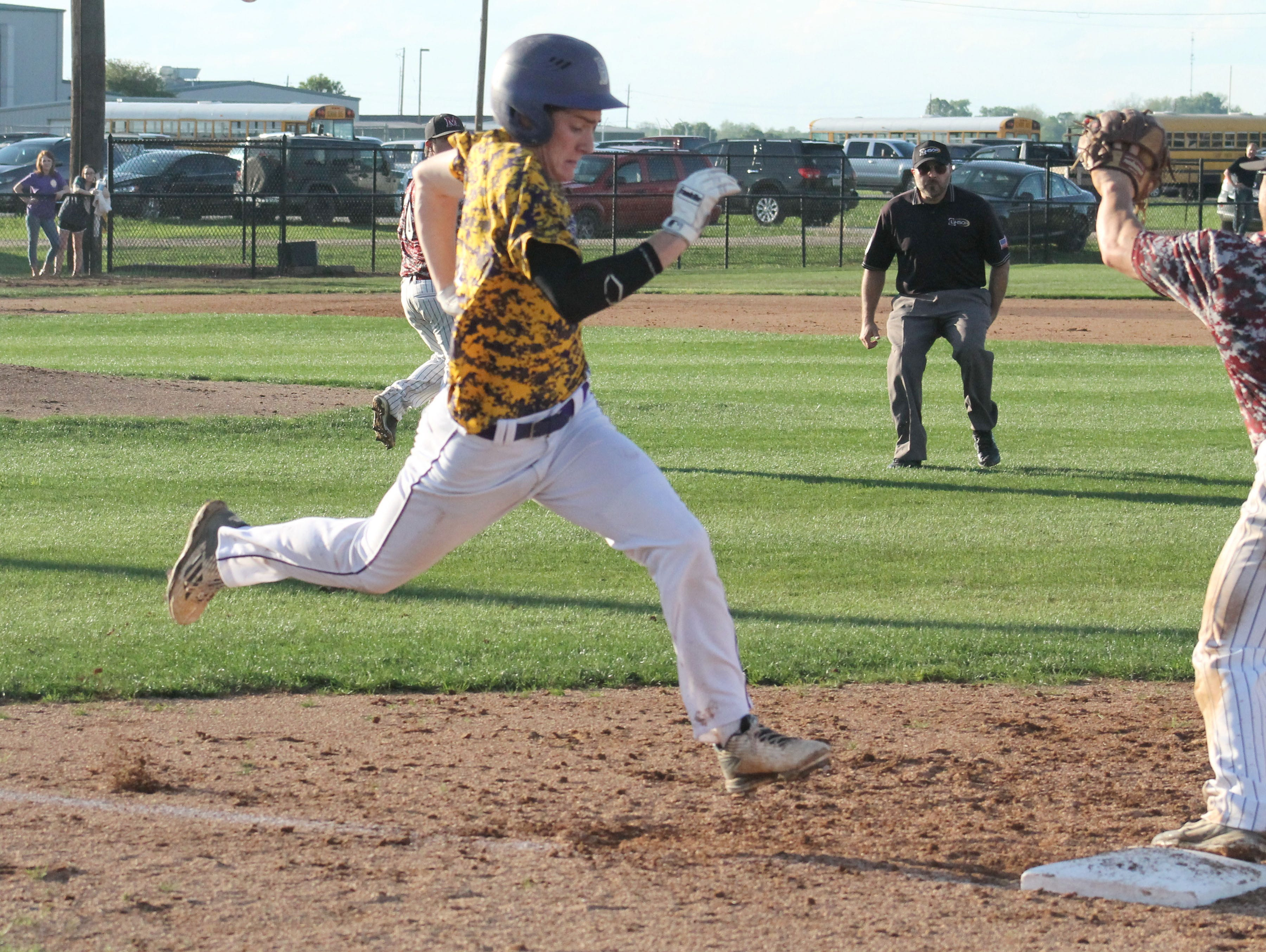 Benton Tigers Cody Norris beats out a bunt against Minden in Thursday's 11-1 win.