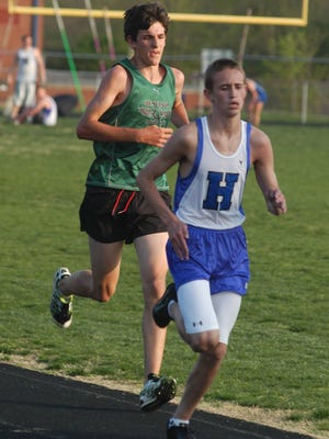 John Michael Griffith of Highlands and Steve Neltner of Bishop Brossart run in the 3,200 meters Lloyd Gold Medal meet.