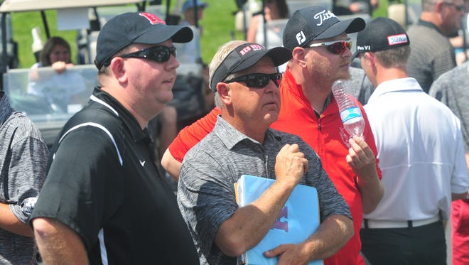 Richmond High School interim athletic director Jeremy Hill, from left, with head coach Ron Murphy and assistant coach Matt Haynes at the IHSAA boys golf Muncie Central regional Thursday, June 8, 2017 at the Players Club in Yorktown.