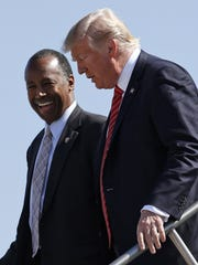 Ben Carson steps off Air Force One with President Trump