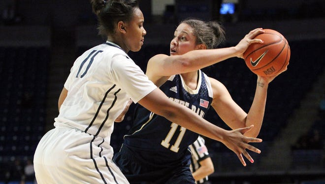 Notre Dame Fighting Irish forward Natalie Achonwa looks to pass the ball as Penn State Lady Lions guard/forward Kaliyah Mitchell guards at Bryce Jordan Center.