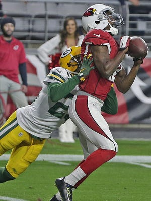 Arizona Cardinals wide receiver John Brown (12) catches a touchdown pass in front of Green Bay Packers cornerback Damarious Randall (23) at University of Phoenix Stadium.