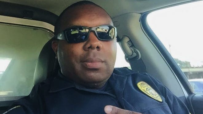 This undated photo provided by Trenisha Jackson shows her husband, Baton Rouge Police Officer Montrell Jackson, one of the three Baton Rouge law enforcement officers who were killed Sunday, July 17, 2016. Three Baton Rouge law enforcement officers investigating a report of a man with an assault rifle were killed Sunday, less than two weeks after a black man was fatally shot by police here in a confrontation that sparked nightly protests that reverberated nationwide. (Courtesy of Trenisha Jackson via AP)
