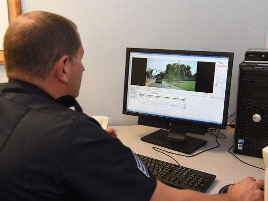 Sgt. Gary Hulbert of the Town of Poughkeepsie Police Dept. reviews a dash camera video at the department headquarters.