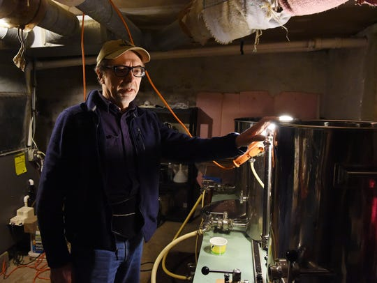 Manny Holl with his homebrewing system in the basement
