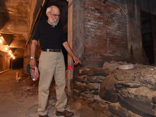 Roy Budnik, a geologist and owner of 489 Main St. in the City of Poughkeepsie, points out the foundation wall for the original trolley barn in the lower level of the property.