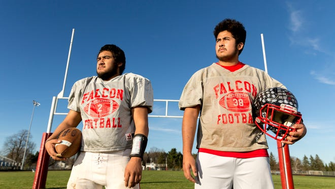 Abbotsford seniors Ramon Aguilera, left, and Izzy Garcia are two of the 15 Hispanic members of the Falcons' football team. They are two of the biggest promoters of the sport at school and in Abbotsford's Hispanic community.