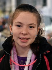 Destiny Hetrick, 11, of York Township, stands for a