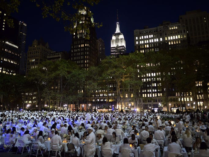 Guests dine during the annual Diner en Blanc on Sept. 18 at Bryant Park in New York City. The world's only viral culinary event, a chic secret pop-up style picnic that originated in France, is celebrating its 25th anniversary.
