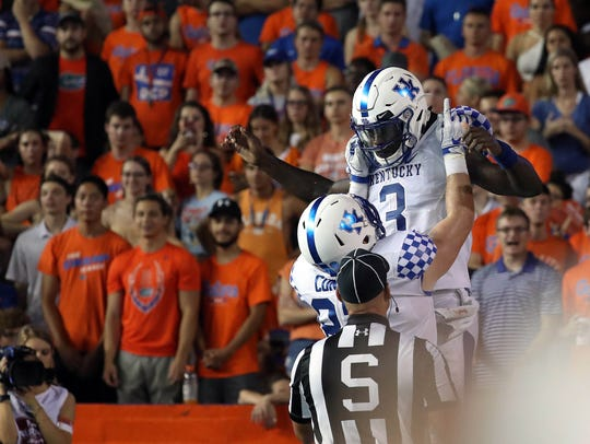 Kentucky quarterback Terry Wilson (3) and the rest of the Wildcats celebrated a rare win over Florida Saturday in the Swamp.