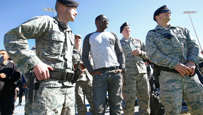 Former Dallas Cowboys wide receiver Michael Irvin visits with members of the security forces during NFL Pro Bowl team practice at Luke Air Force Base on Thursday, Jan. 22 2015 in Glendale, AZ.