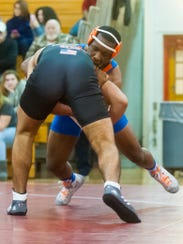 Millville's Dequan Maven, facing, squares off with