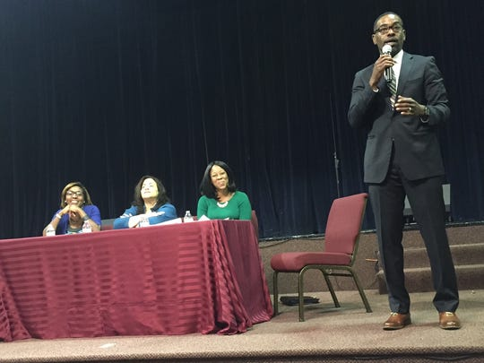 Rodney Harris of the Hamilton County Public Defender's Office discusses jury selection during a panel organized by the Black Lawyers Association. Seated are (from left) Yvette Simpson, Nadine Allen and Donyetta Bailey.
