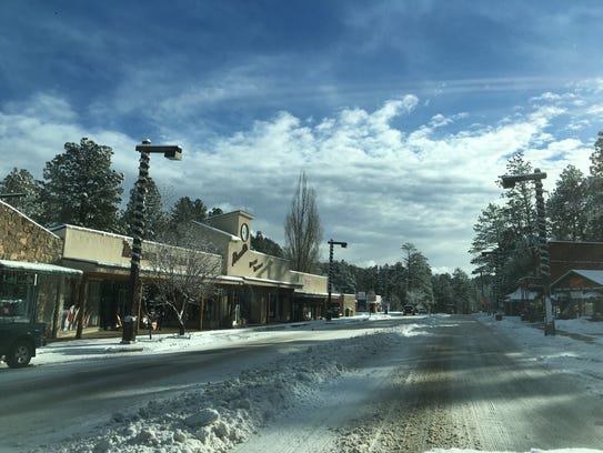 Sudderth Drive was shaking off Thursday evening's snowfall