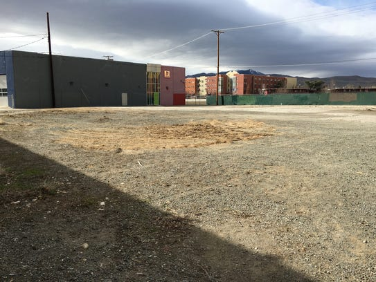 235 Ralston St. is currently a vacant lot next door
