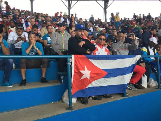 A fan watches pregame festivities at Latinoamerican