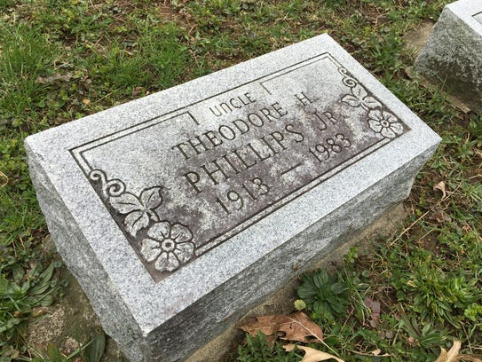 The tombstone of Theodore Phillips Jr. in Muncie's
