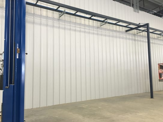 Catwalks in a shop at the new facility will feed supplies,