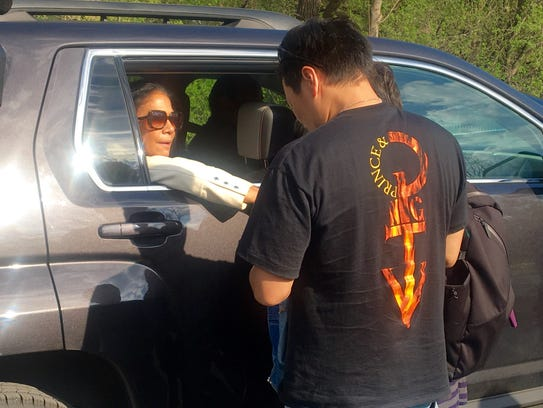 Former Prince drummer Sheila E. consoles a fan as she