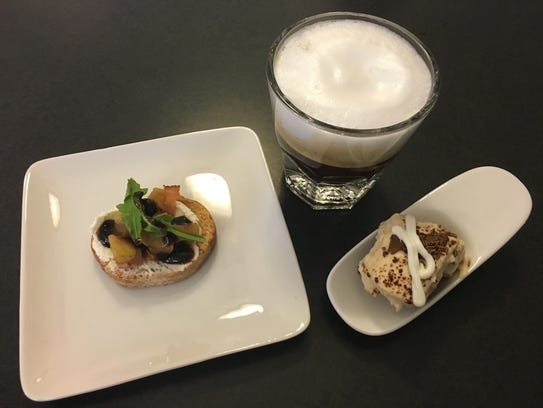 A crouton topped with goat cheese, caramelized pears, arugula and a vinaigrette served with a coconut cream coffee and tiramisu. This was a course in the 2016 Chef Challenge for Children.