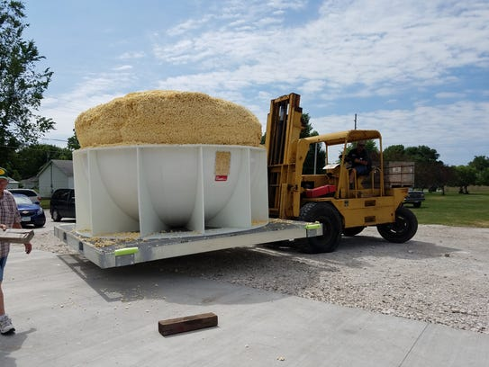 Heavy equipment is used to move a ball of popcorn estimated