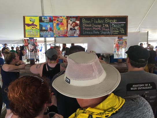 People wait in line at the Odd Side Ales booth Friday,