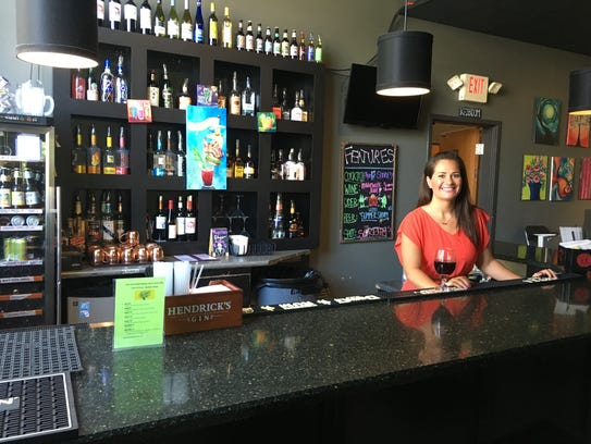 Kelly Cannizzaro, the new owner of Arté Wine and Painting