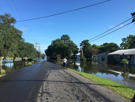 Some homes and roads in Crowley were flooded Monday