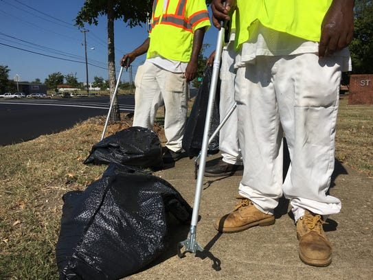 Inmates from Red Eagle Honor Farm volunteered to clean
