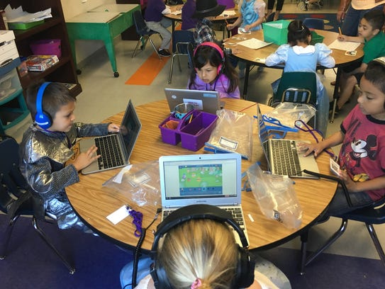 Students work on their laptops at Rocketship Brilliant