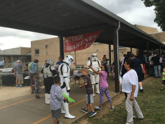 Stormtroopers greet children on Saturday at the annual