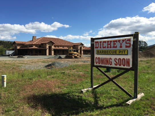 The new Dickey's BBQ promised in this sign across U.S.