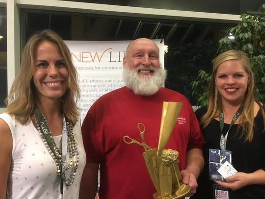 Rock Paper Scissors Tournament winner Ray Racine of