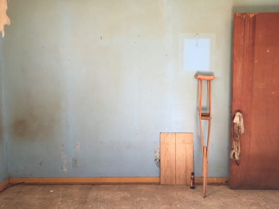 Mold is visible behind a panel in an empty room in