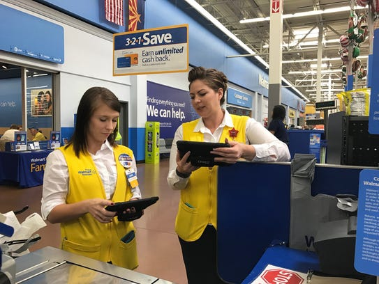 Laura Roberts, 36, trains Walmart supervisor Anna Jordan,