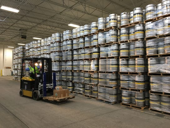 A forklift is driven in front of stacks of kegs in September 2016 at Bell's Comstock Brewery in Galesburg.