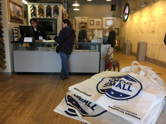 Shoppers explore Gordy Fine Arts and Framing in downtown