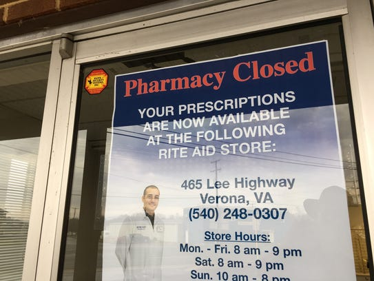 A sign at the Verona Pharmacy stating it has closed.