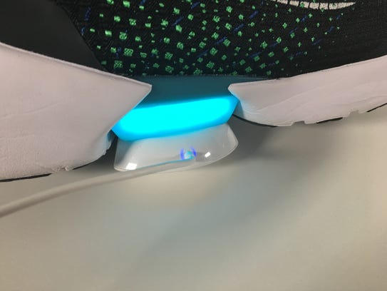 The battery indicator and magnetic charger for Nike's